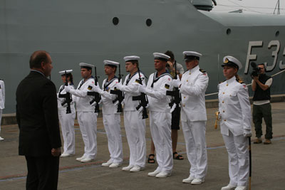 The Danish Minister of Defence is saluted by the ships Guard of Honour